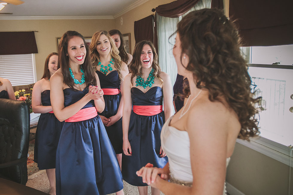 Bridesmaids thrilled to see the bride in her dress at Tennessee RiverPlace